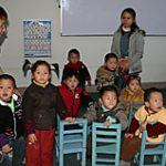 A group of small children waits to receive hearing screening services.